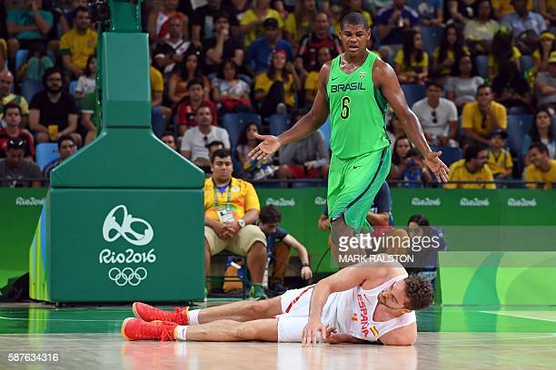 TOPSHOT Spain's centre Pau Gasol falls next to Brazil's centre Cristiano Felicio during a Men's round Group B basketball match between Spain and...