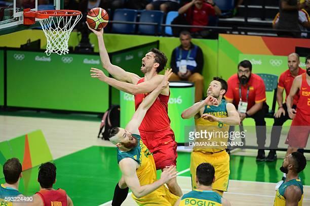 Spain's centre Pau Gasol goes to the basket between Australia's forward Aron Baynes and Australia's guard Matthew Dellavedova during a Men's Bronze...