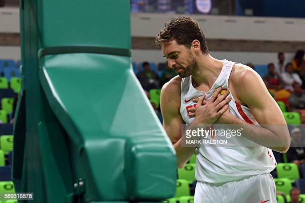 TOPSHOT Spain's centre Pau Gasol holds his chest during a Men's round Group B basketball match between Spain and Lithuania at the Carioca Arena 1 in...