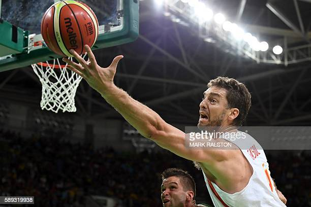 Spain's centre Pau Gasol reaches out to the ball during a Men's round Group B basketball match between Spain and Lithuania at the Carioca Arena 1 in...