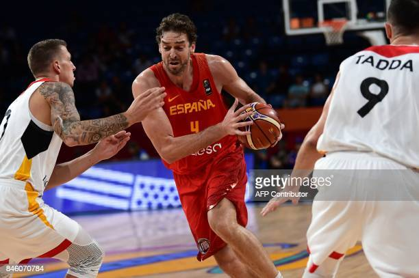 TOPSHOT Spain`s centre Pau Gasol runs with the ball as Germany`s forward Daniel Theis and Karsten Tadda look on during FIBA Eurobasket 2017 men`s...