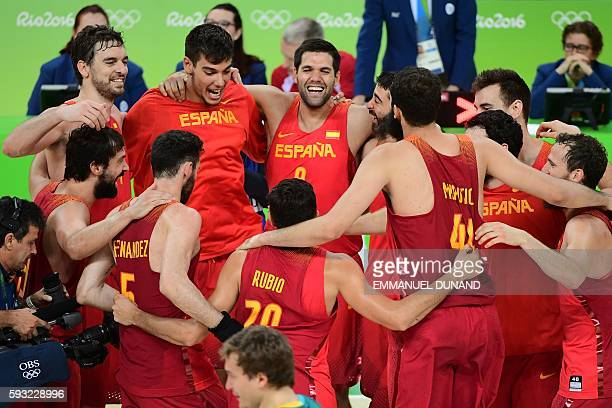 Spain's centre Pau Gasol Spain's power forward Felipe Reyes and Spain's players celebrate after defeating Australia during a Men's Bronze medal...