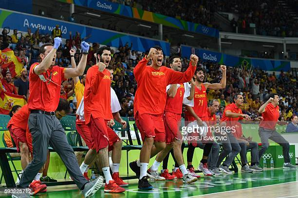 Spain's centre Willy Hernangomez and teammates react from the bench during a Men's Bronze medal basketball match between Australia and Spain at the...