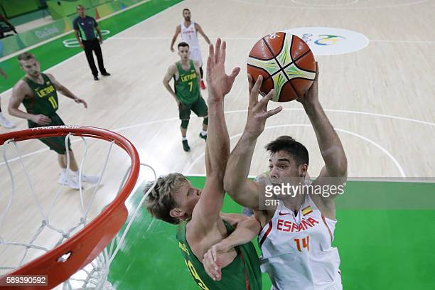 Spain's centre Willy Hernangomez jumps for a basket by Lithuania's small forward Mindaugas Kuzminskas during a Men's round Group B basketball match...