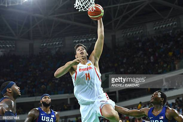 Spain's centre Willy Hernangomez jumps for a basket during a Men's semifinal basketball match between Spain and USA at the Carioca Arena 1 in Rio de...