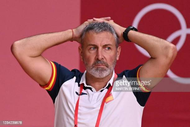Spain's coach Carlos Enrique Viver Arza looks on during the women's preliminary round group B handball match between France and Spain of the Tokyo...