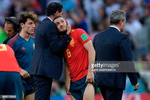 Spain's coach Fernando Hierro comforts Spain's midfielder Koke after loosing the penalty shootout at the end of the Russia 2018 World Cup round of 16...