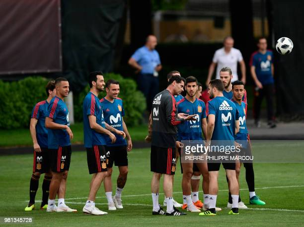 Spain's coach Fernando Hierro speaks with Spain's defender Nacho Fernandez during a training session at Krasnodar Academy on June 22 during the...