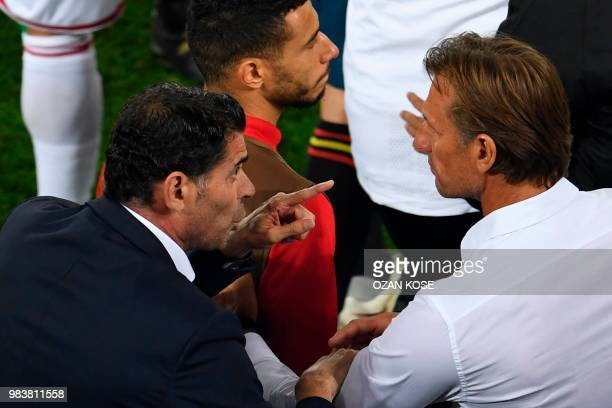 Spain's coach Fernando Hierro talks to Morocco's French coach Herve Renard during the Russia 2018 World Cup Group B football match between Spain and...