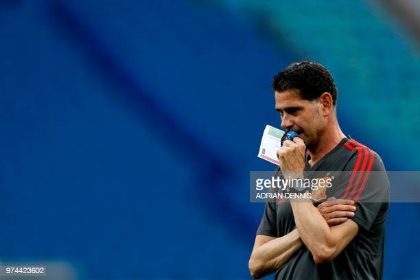 TOPSHOT Spain's coach Fernando Hierro watches his team players during a training session at the Fisht Olympic Stadium in Sochi on June 14 on the eve...