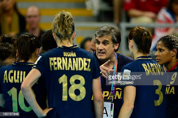 Spain's coach Jorge Duenas de Galarza speaks to his players during the women's bronze medal handball match South Korea vs Spain for the London 2012...