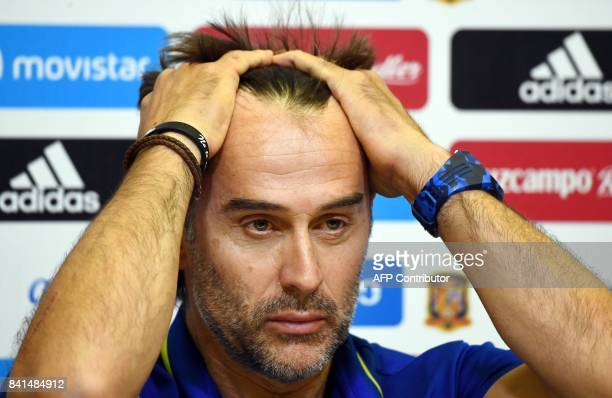 Spain's coach Julen Lopetegui gestures during a press conference at the Royal Spanish Football Federation's 'Ciudad del Futbol' in Madrid on...