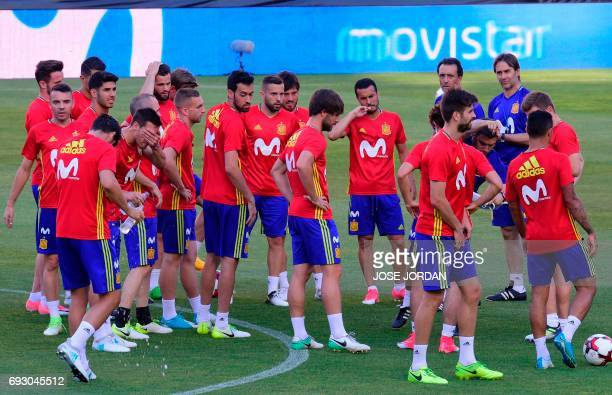 Spain's coach Julen Lopetegui look at his players during the training session at the New Condomina stadium in Murcia on June 6 2017 on the eve of...