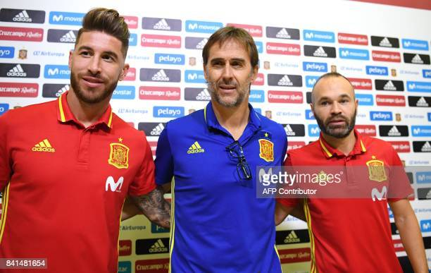 Spain's coach Julen Lopetegui poses with Spain's defender Sergio Ramos and Spain's midfielder Andres Iniesta prior to giving a press conference at...