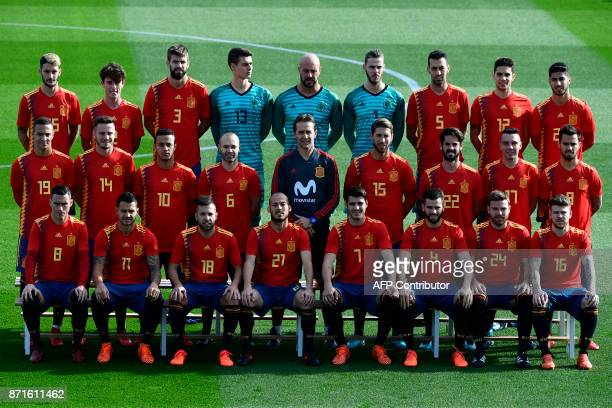 Spain's coach Julen Lopetegui poses with Spain's national football players wearing theit new jerseys at the Ciudad del Futbol in Las Rozas near...