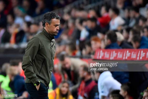 Spain's coach Luis Enrique reacts at the end of the Euro 2020 group F qualifying football match between Spain and Norway at the Mestalla Stadium in...