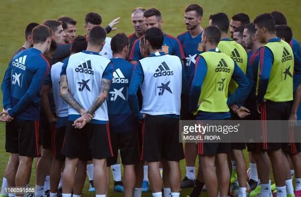 Spain's coach Robert Moreno gives instructions to his players during a training session at El Molinon stadium in Gijon on September 7 on the eve of...