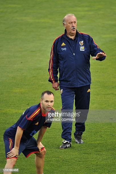Spain's coach Vicente del Bosque gestures next to Spain's midfielder Andres Iniesta during a training at AFG Arena stadium on the eve of a friendly...