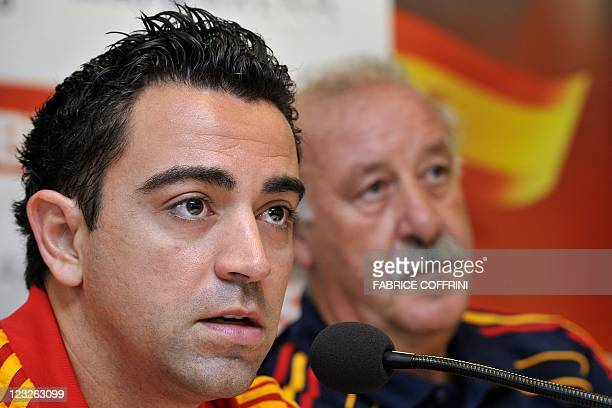 Spain's coach Vicente del Bosque listens to Spain's midfielder Xavi Hernandez during a press conference at AFG Arena in St Gallen on September 1 on...