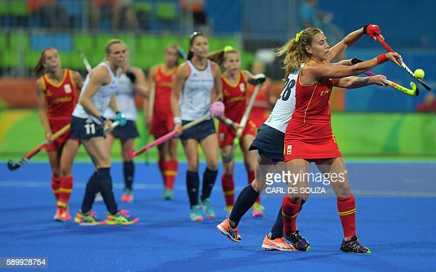 Spain's Cristina Guinea vies with Britain's Nicola White during the women's quarterfinal field hockey Britain vs Spain match of the Rio 2016 Olympics...