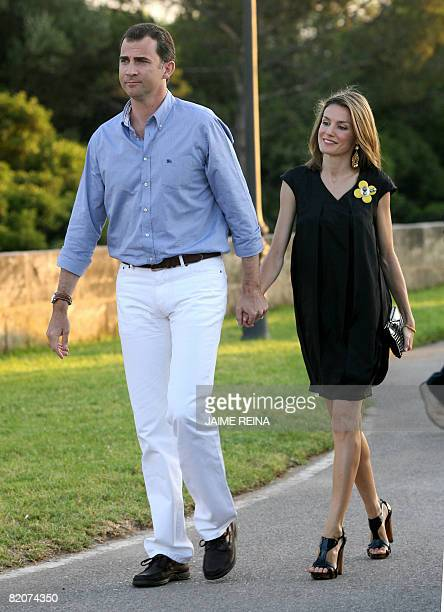 Spain's Crown Prince Felipe and Princess Letizia arrive at the trophy ceremony of a regatta on July 26 2008 at San Carlos's Castle in Palma de...