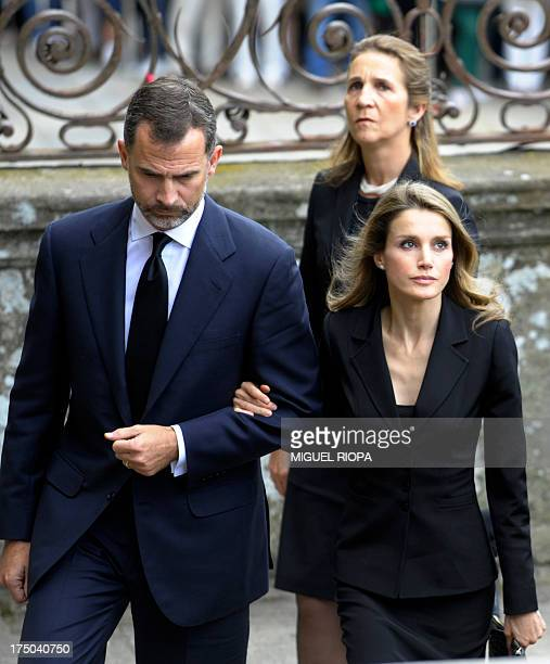 Spain's Crown Prince Felipe and Spain's Princess Letizia arrive followed by Spain's Infanta Elena to attend a memorial service for the victims the...