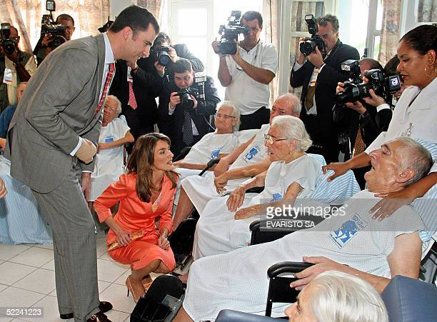 Spain's Crown Prince Felipe de Borbon and Princess Letizia Ortiz speak with an elderly lady during a visit to the Spanish Hospital in Salvador Bahia...