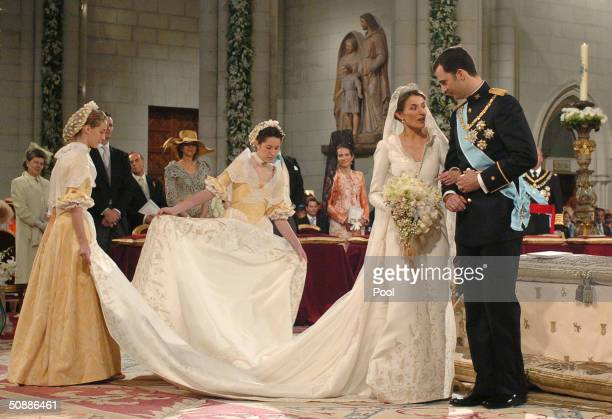 Spain's Crown Prince Felipe de Bourbon stands next to his bride Letizia Ortiz as they marry in Almudena cathedral May 22 2004 in Madrid