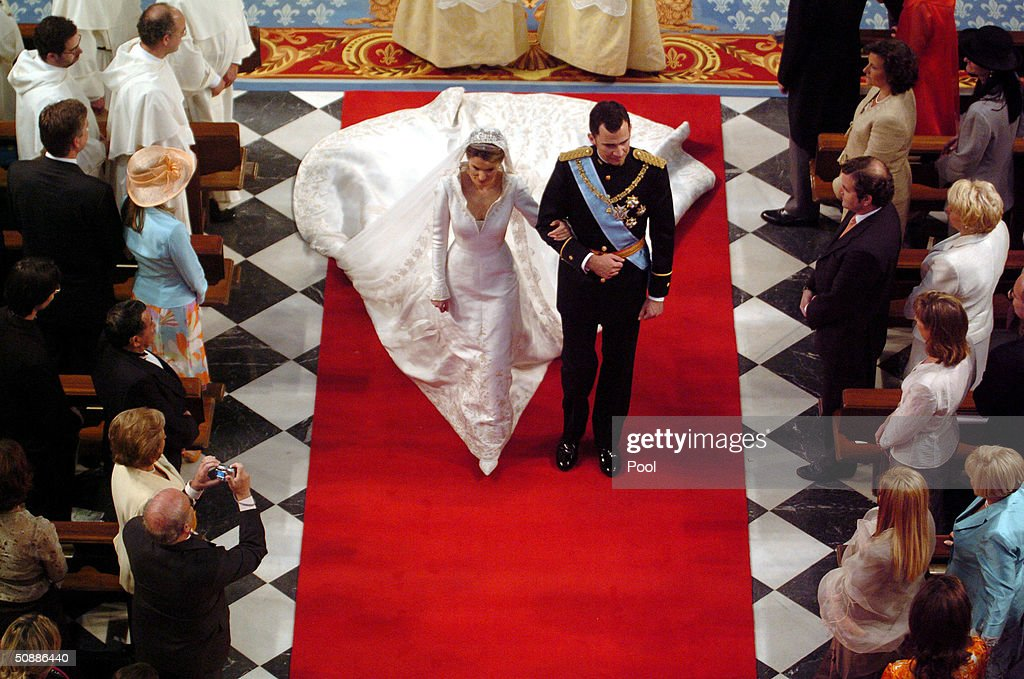 Spain's Crown Prince Felipe de Bourbon walks next to his bride Letizia Ortiz during their wedding ceremony in Almudena cathedral May 22, 2004 in Madrid.