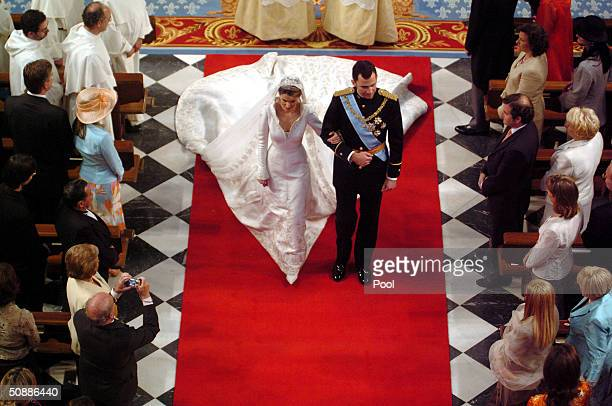 Spain's Crown Prince Felipe de Bourbon walks next to his bride Letizia Ortiz during their wedding ceremony in Almudena cathedral May 22 2004 in Madrid