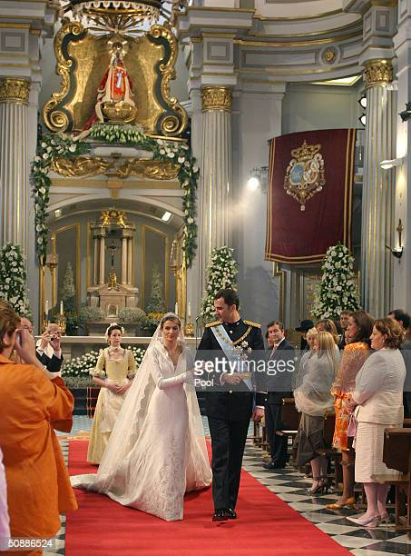 Spain's Crown Prince Felipe de Bourbon walks next to his bride princess Letizia Ortiz after their wedding ceremony in Almudena cathedral May 22 2004...