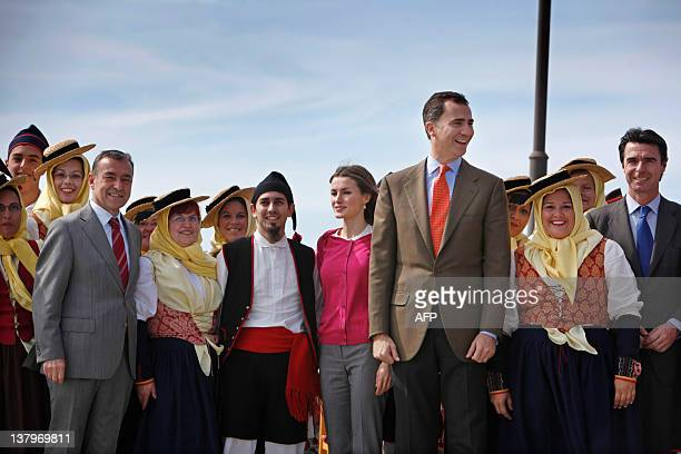 Spain's Crown Prince Felipe his wife Spain's Princess Letizia and Spain's Minister of Industry Energy and Tourism Jose Manuel Soria visit the Spanish...