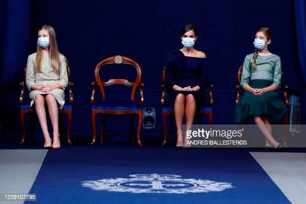 Spain's Crown Princess Leonor, Queen Letizia and Princess Sofia attend the 2020 Princess of Asturias award ceremony at the Reconquinta Hotel in...