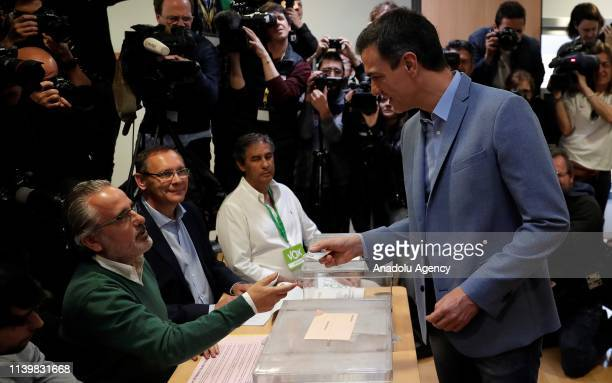 Spains current PM and Spanish Socialist Workers' Party leader Pedro Sanchez cast his vote with his wife Maria Begona Gomez at a polling station...