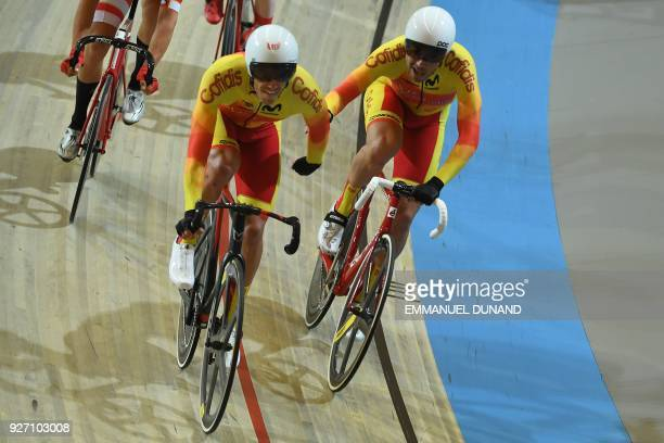Spain's cycling team relay during the men's madison final during the UCI Track Cycling World Championships in Apeldoorn on March 4 2018 / AFP PHOTO /...