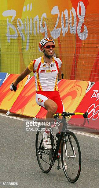 Spain's cyclist Samuel Sanchez slows down after crossing the finish line of the men's road race at the 2008 Beijing Olympic Games in the first place,...