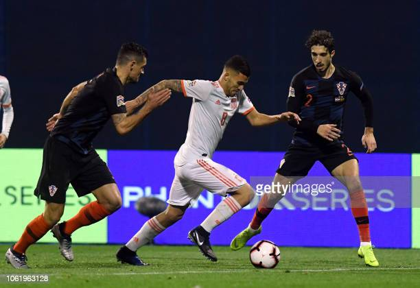 Spain's Dani Ceballos vies for the ball with Croatia's Sime Vrsaljko and Dejan Lovren during the UEFA Nations League football match between Croatia...