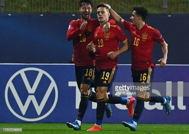 Spain's Dani Gomez is is congratulated by team mates Javier Puado and Manu Garcia during the 2021 UEFA European Under 21 Championship Group B...