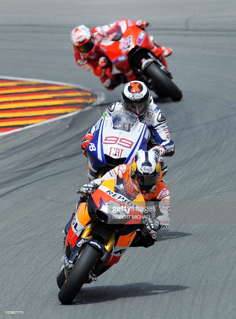 Spain's Dani Pedrosa of the Repsol Honda team rides ahead of ahead of Spains's Yamaha driver Jorge Lorenzo and Ducati driver Casey Stoner of Australia during the the race of the Moto Grand Prix of Germany at Sachsenring Circuit on July 18, 2010 in Hohenstein-Ernstthal, eastern Germany. Pedrosa won the race ahead of Lorenzo and Stoner (third).