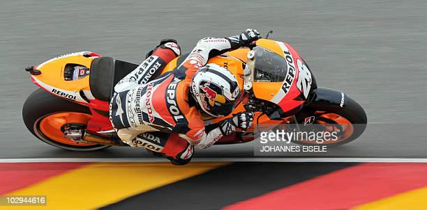 Spain's Dani Pedrosa of the Repsol Honda team steers his bike during the second free practice session of the MotoGP race at the Sachsenring Circuit...