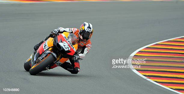 Spain's Dani Pedrosa of the Repsol Honda team steers his bike during the qualifying practice of the MotoGP race at the Sachsenring Circuit on July 17...