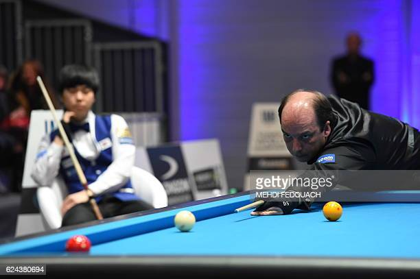 Spain's Daniel Sanchez competes against South Korea's Kim Haengjik to win the final of the 69th World Championship Three Cushion Individuals in...