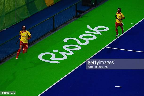 Spain's David Alegre celebrates scoring a goal during the mens's field hockey Britain vs Spain match of the Rio 2016 Olympics Games at the Olympic...
