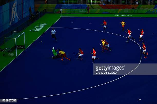 Spain's David Alegre scores a goal past Great Britain's George Pinner during the mens's field hockey Britain vs Spain match of the Rio 2016 Olympics...