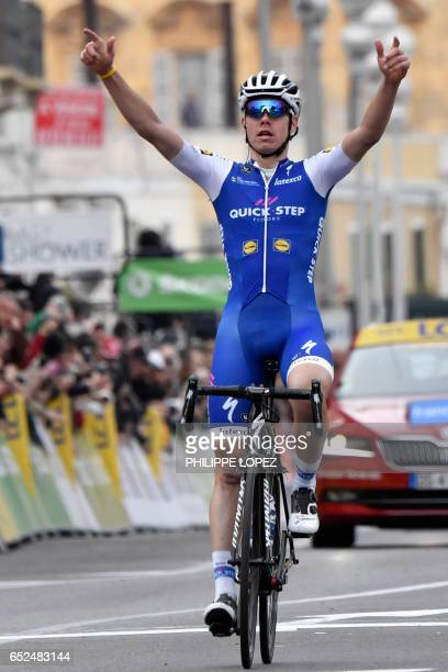 Spain's David De la Cruz celebrates as he crosses the finish line at the end of the 1155 km eighth and last stage of the 75th edition of the...