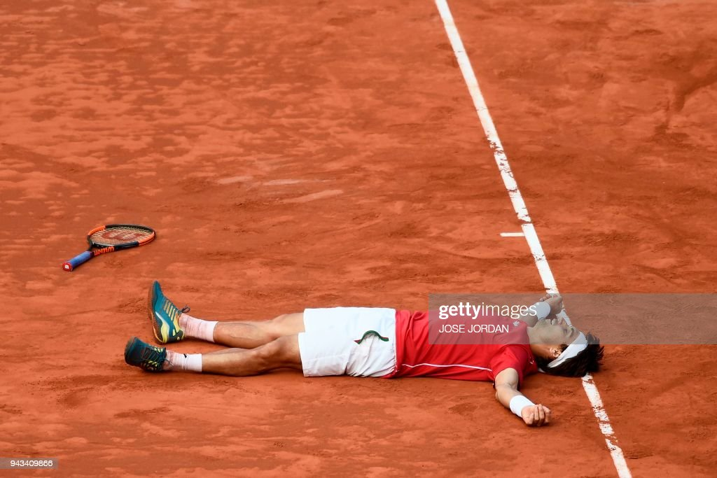 Spain's David Ferrer celebrates after beating Germany's Philipp Kohlschreiber during the Davis Cup quarter-final tennis match at the bullring of Valencia on April 8, 2018. /
