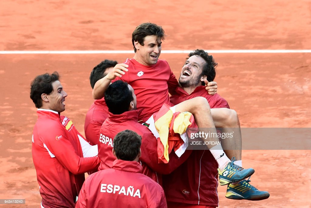 Spain's David Ferrer is carried by teammates as they celebrate after beating Germany during the Davis Cup quarter-final tennis match at the bullring of Valencia on April 8, 2018. /