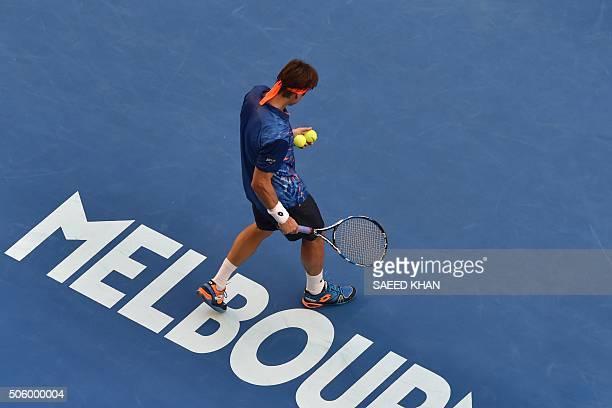 Spain's David Ferrer prepares to serve against Australia's Lleyton Hewitt during their men's singles match on day four of the 2016 Australian Open...
