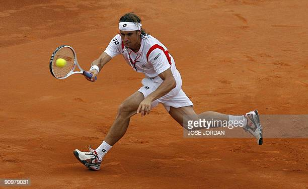 Spain's David Ferrer returns the ball against Israeli Andy Ram during the fourth match of the Davis cup semifinal between Spain and Israel at the...