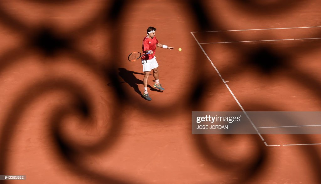 Spain's David Ferrer returns the ball during the Davis Cup quarter-final tennis match against Germany's Philipp Kohlschreiber at the bullring of Valencia, on April 8, 2018. /